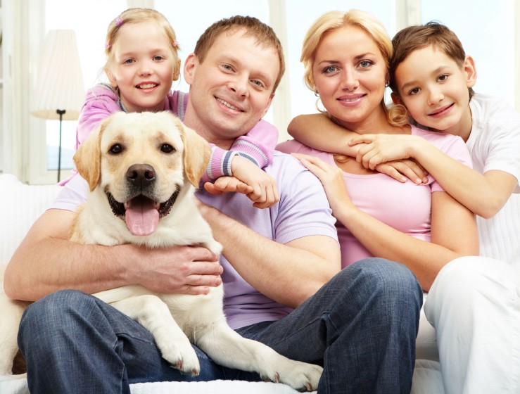 Happy Family with their Golden Retriever Dog